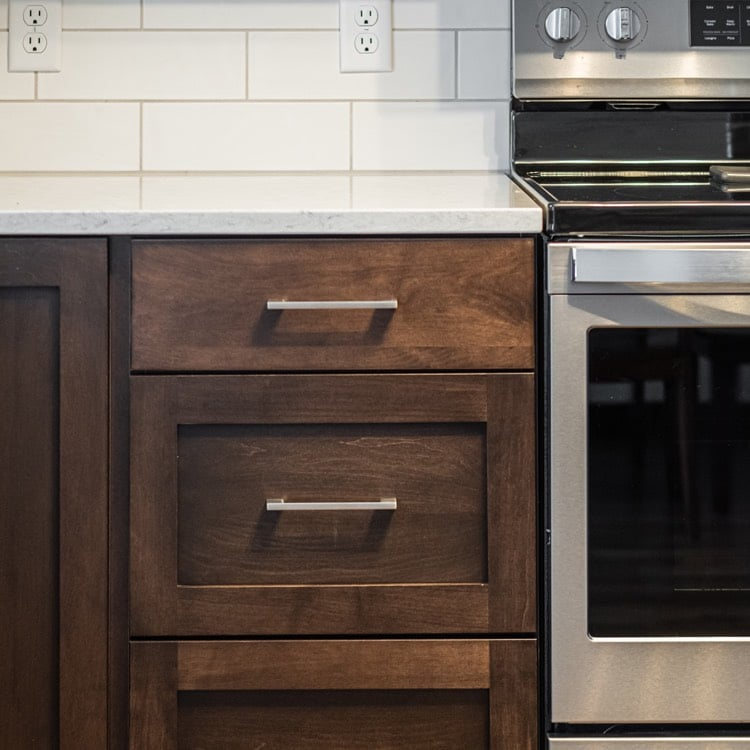 Welcoming wood tones are a highlight of these remodeled kitchen cabinets in Fargo, ND.